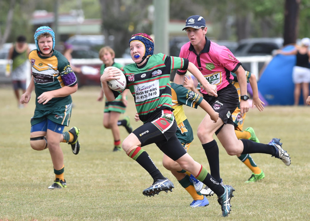 Jock Butterfield Memorial Junior Rugby League Carnival - U/12 Seagulls green V. Burrum Miners. Harry Armstrong (Seagulls) sprints for the line.