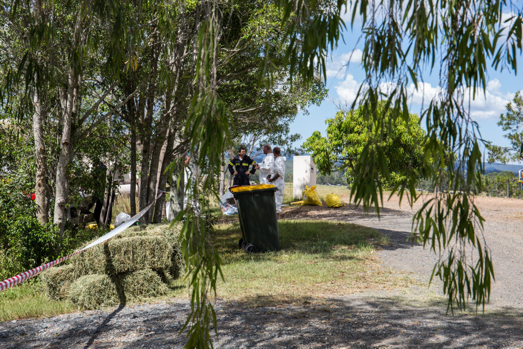 Crews work to remove biohazard material from the property at Lagoon Pocket following rumours of a Hendra Virus infection.
