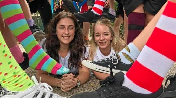 Bonnie Searle and Emelie Orrell among crazy socks at Nambour State College with funds raised going to Elki Guymer's family.