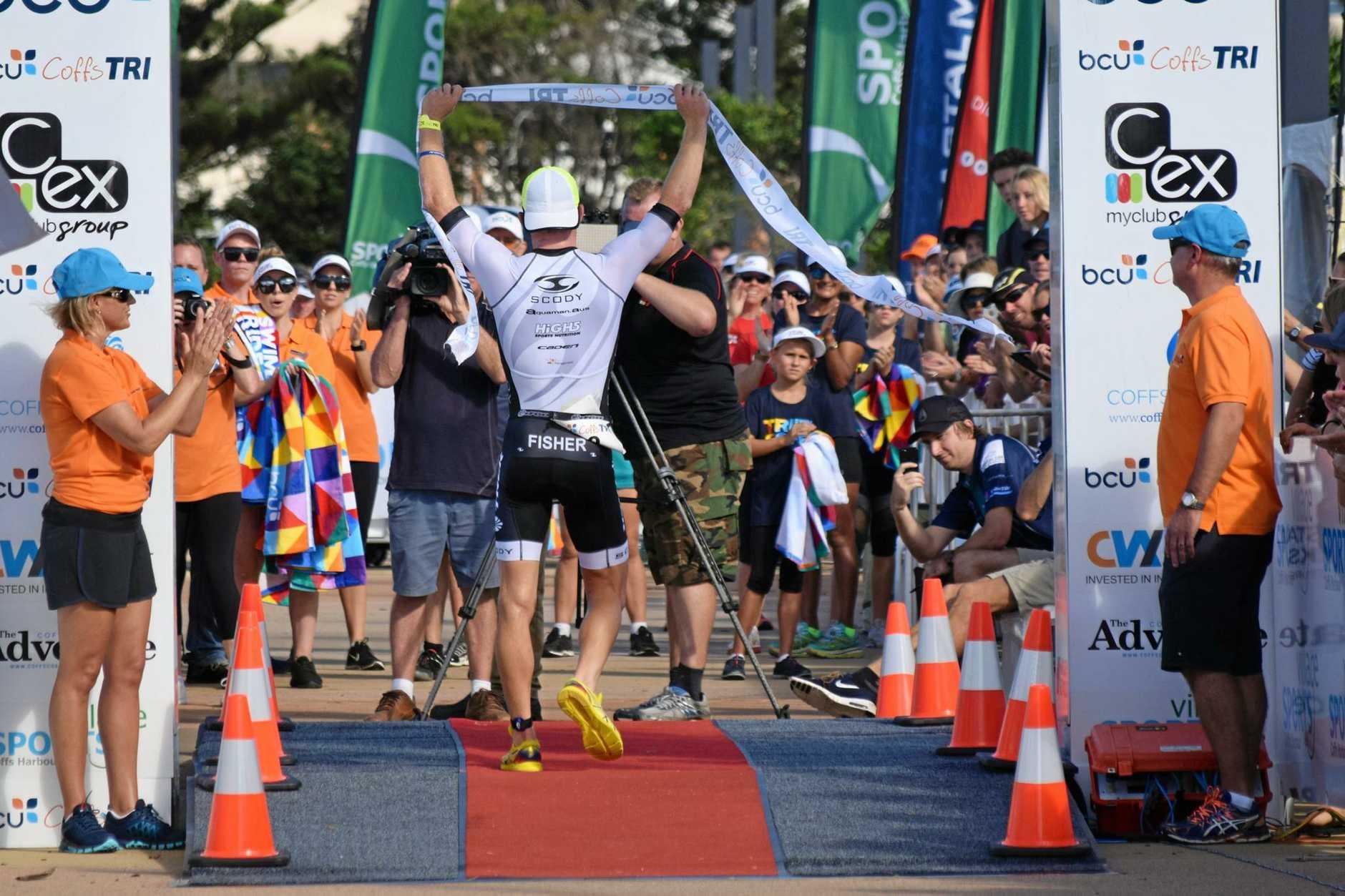 WINNER: Ryan Fisher crosses the bcu Coffs Tri finish line in race record time. 5 March 2017 triathlon Photo: Brad Greenshields/Coffs Coast Advocate