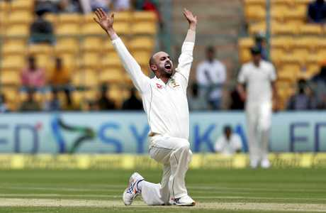 Australia's Nathan Lyon appeals successfully for the wicket of India's captain Virt Kohli during the first day of their second test cricket match in Bangalore, India, Saturday, March 4, 2017. (AP Photo/Aijaz Rahi)