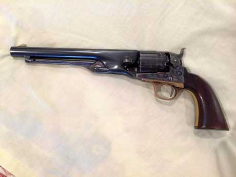 LOOKALIKE: Gun collector Bryan McGuren owns a similar Colt pistol to the missing one, but it is of inferior quality.