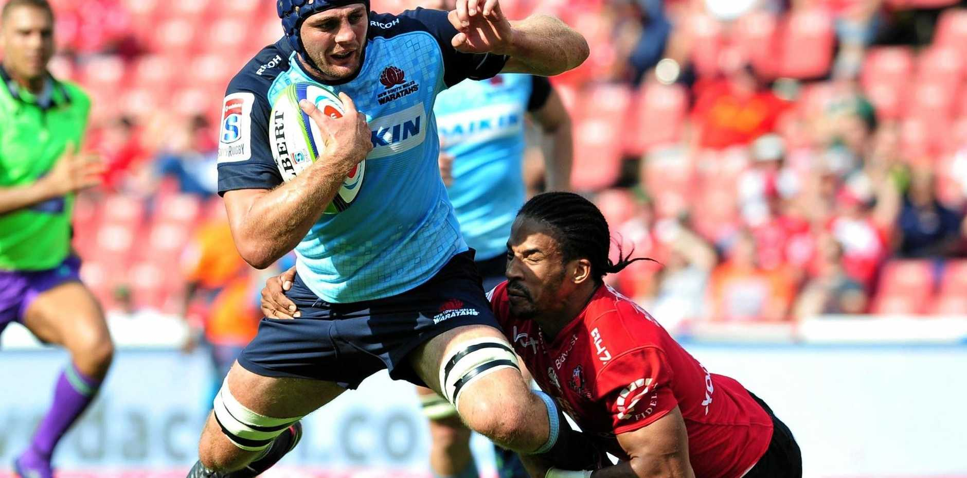 CRASH: Waratahs' Dean Mumm is about to hit the deck after being tackled by Courtnall Skosan in the Lions' mauling win at Ellis Park, Johannesburg.