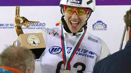 Australia's Lydia Lassila reacts with her trophy after winning the ladies aerials World Cup freestyle skiing event in Moscow, Russia