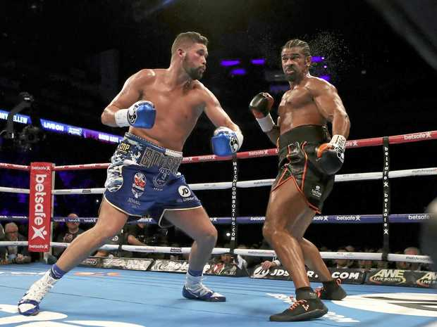 WATCH OUT: Tony Bellew (left) is about to unload a heavy right hand on fellow Briton David Haye