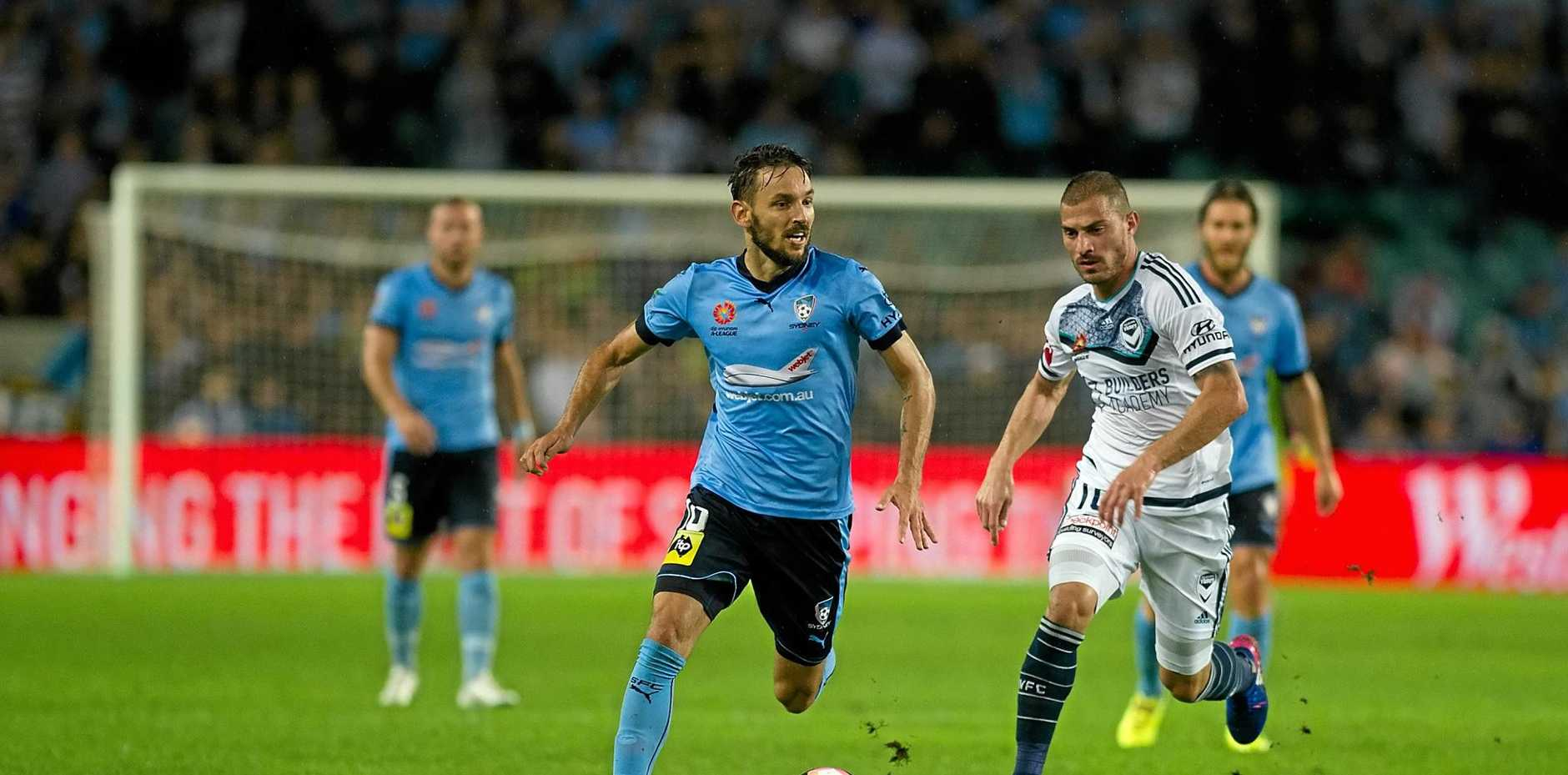 Milos Ninkovic of Sydney FC and James Troisi of Melbourne Victory during the round 22 A-League match between Sydney FC and Melbourne Victory at Allianz Stadium in Sydney, Friday, March 3, 2017. (AAP Image/Joel Carrett) NO ARCHIVING, EDITORIAL USE ONLY