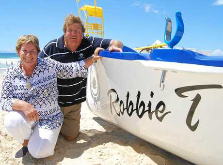 Cyril and Diane Thomasson celebrate the launch of a new surf boat named in honour of their late son Robert.
