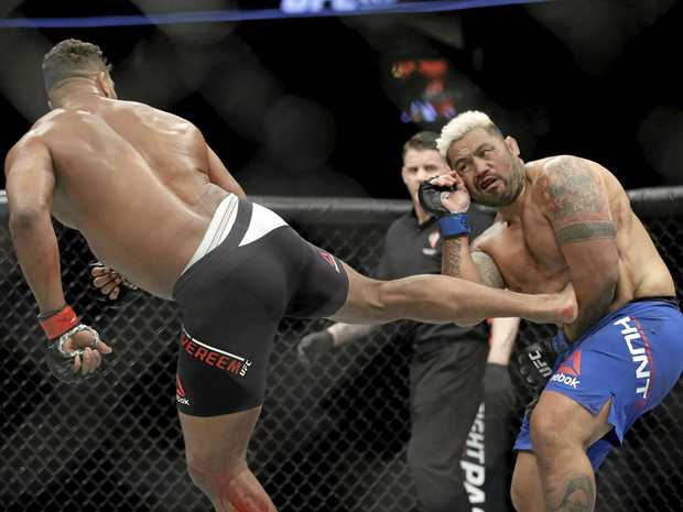 Alistair Overeem kicks Mark Hunt during a heavyweight mixed martial arts bout at UFC 209.