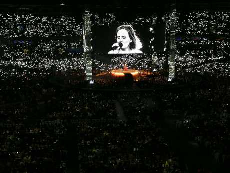 Adele lights up The Gabba as fans shine a phone light for the superstar.