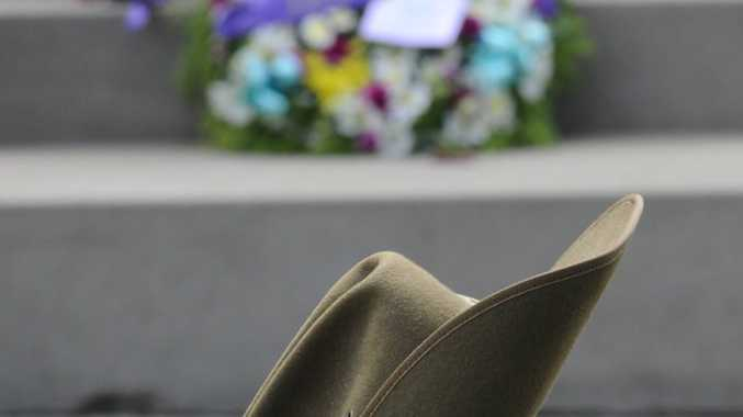 A slouch hat sits in front of the South Grafton cenotaph at the Anzac Day ceremony. Photo Adam Hourigan / The Daily Examiner