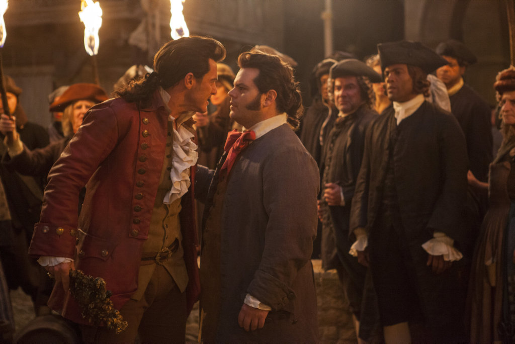 Luke Evans and Josh Gad in a scene from the movie Beauty and the Beast.