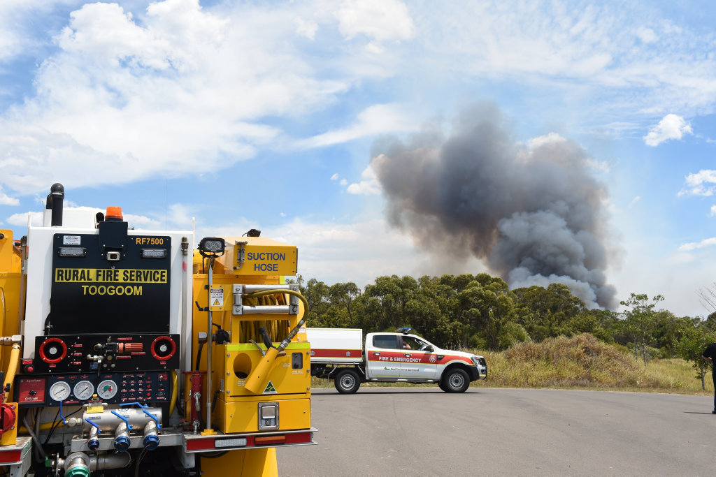 Fire crews prepare to enter Burrum Coast National Park to battle a blaze. The fire restarted that morning, and has burned for a total of three days.