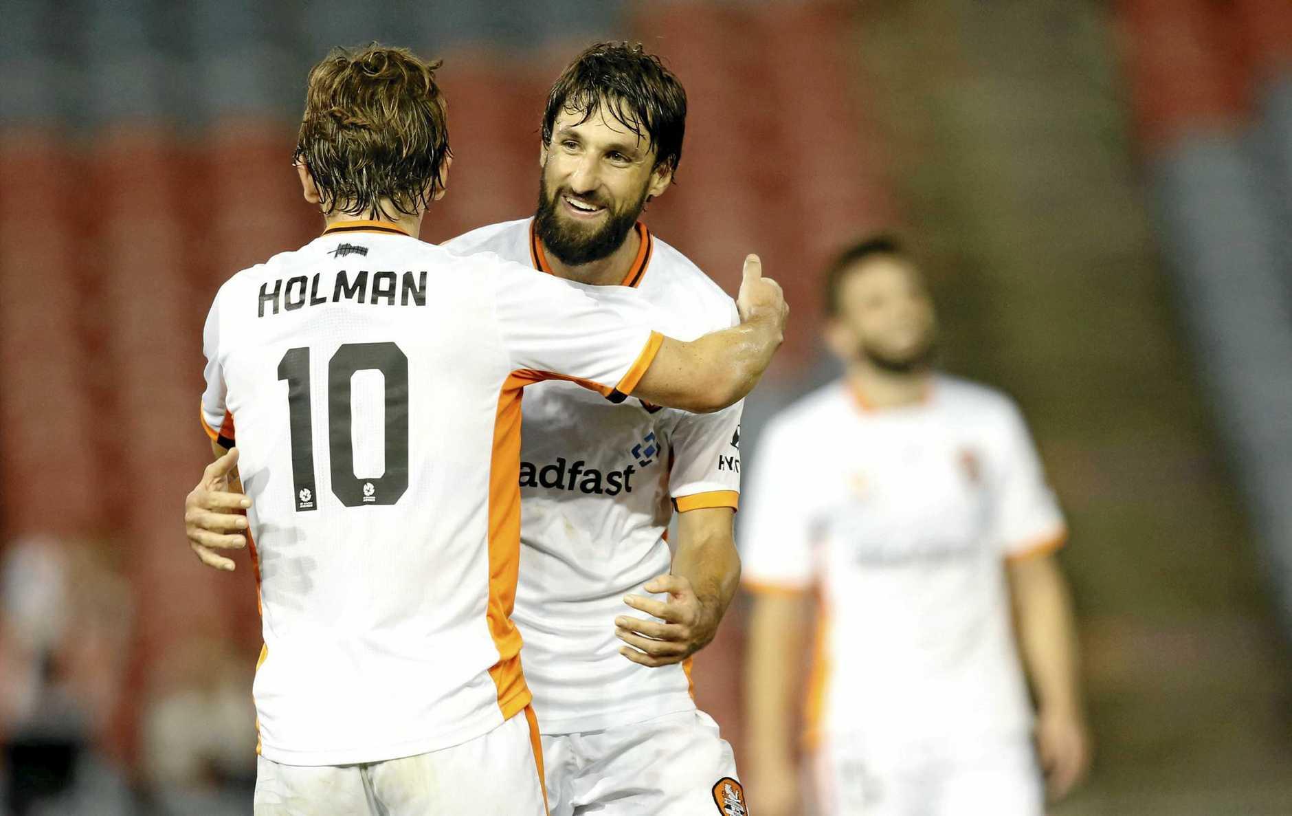 Brett Holmann and Thomas Broich of Brisbane Roar celebrate the win.