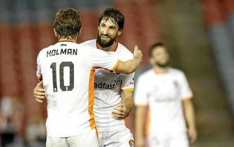 Brett Holmann and Thomas Broich of Brisbane Roar celebrate the win.