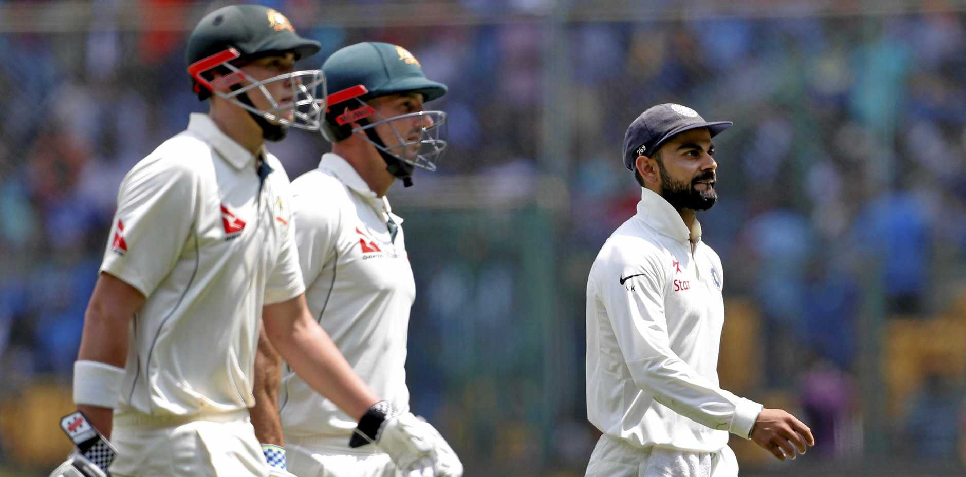India's captain Virat Kohli, right, walks back with Australia's batsmen Matt Renshaw, left, and Shaun Marsh for the lunch break during the second day of their second Test cricket match in Bangalore