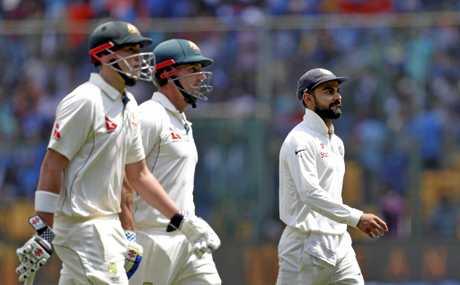 India's captain Virat Kohli, right, walks back with Australia's batsmen Matt Renshaw, left, and Shaun Marsh for the lunch break