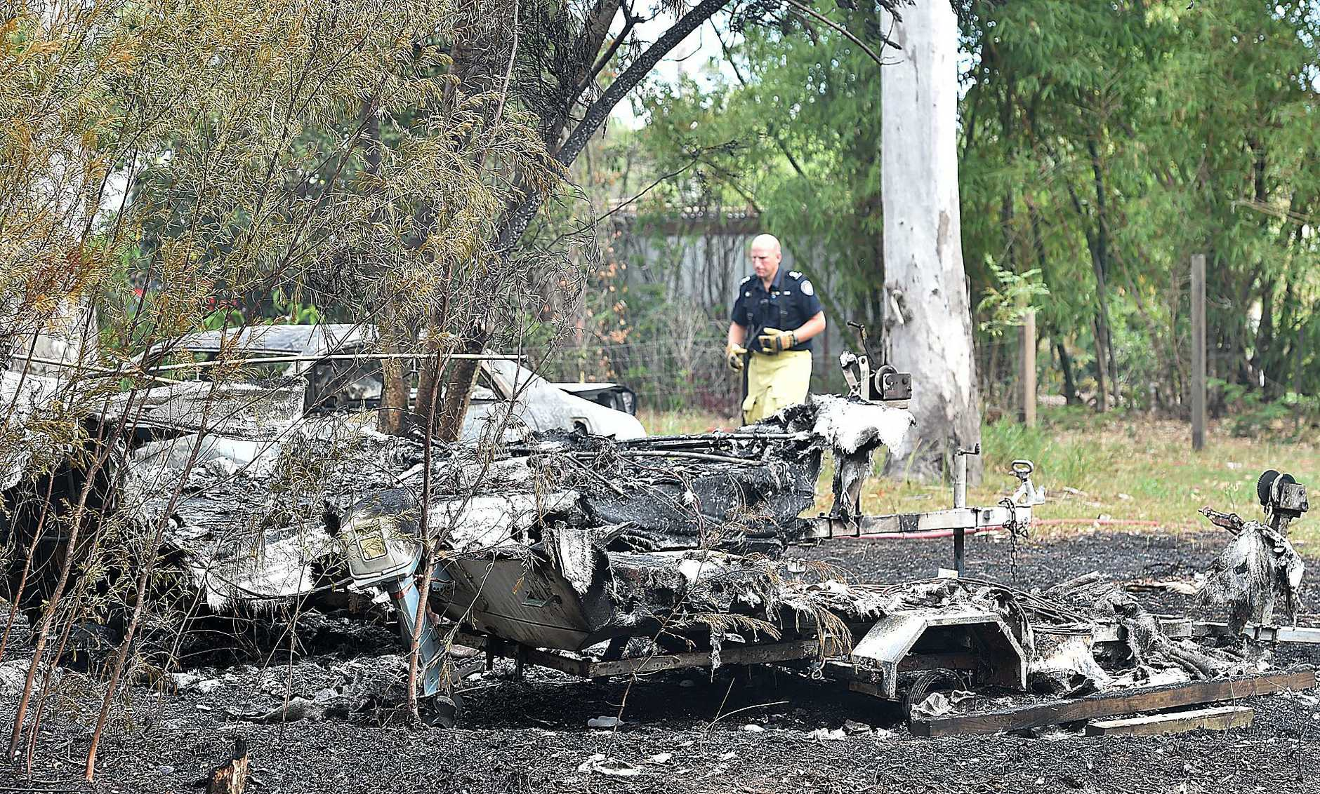 Fire in the backyard of a property on Pacific Haven Circuit where two cars and two boats were engulfed by fire.