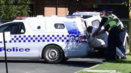 The woman accused of drowning her son in the Murray River is led away by police. Picture: Ivy Wise/ Riverine Herald.