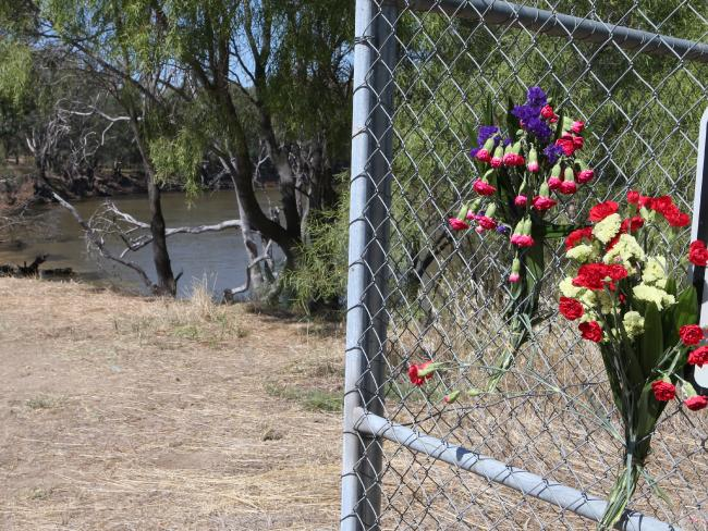 Flowers have been placed on the banks of the Murray River in Moama where the body of a five year old boy was found after his mother allegedly drowned him. Picture: David Crosling