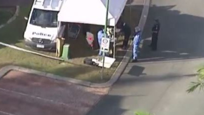 The homicide squad is investigating after a man's body was found at a residence on College Road, Karana Downs. Picture: Nine News Brisbane