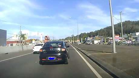 A passenger hurls abuse at a female motorist on Maroochydore Rd.