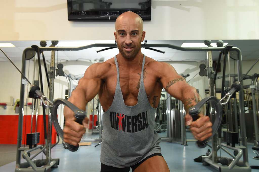 Hervey Bay bodybuilder Cameron Colhoun working out at the gym.