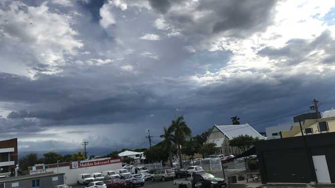 A storm cell is heading to Mackay and the sky is darkening