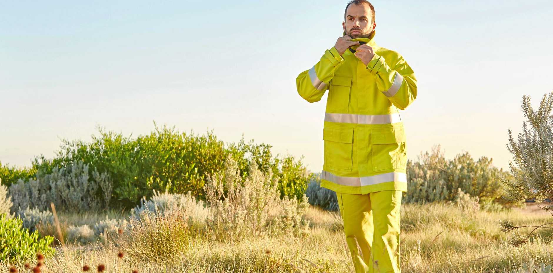 David Hack models the newly designed fire protection suits that are available for farmers across Australia to buy.