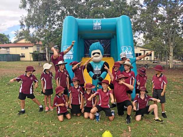 Brisbane Heat mascot 'Heater' visited schools in the Burnett.