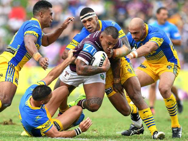 Addin Fonua-Blake of the Sea Eagles is tackled by the Eels defence.