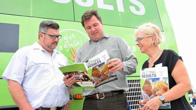 PASSIONATE ISSUE: Queensland Teachers Union deputy general Brendan Crotty, central Queensland organiser Dan Coxen and central Queensland teacher Helen Bond with the Gonski bus in Gladstone.