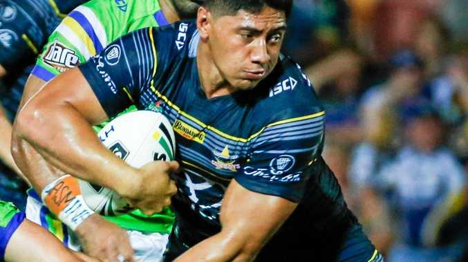 Cowboys Jason Taumalolo breaks free from the Raiders defence.