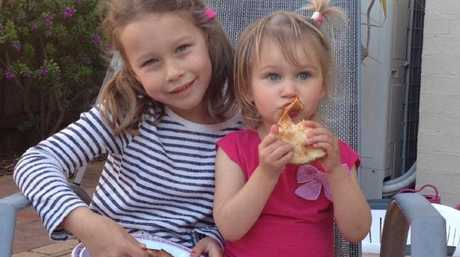 Carys Bradshaw (left), pictured with her little sister, has a devastating prognosis. Source:Supplied