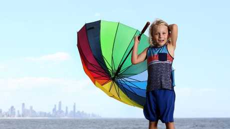 Finley Supanz, 7, from Burleigh Waters isn't sure if he will need is umbrella after the BOM continues to say to prepare for wet weather. Picture: Adam Head