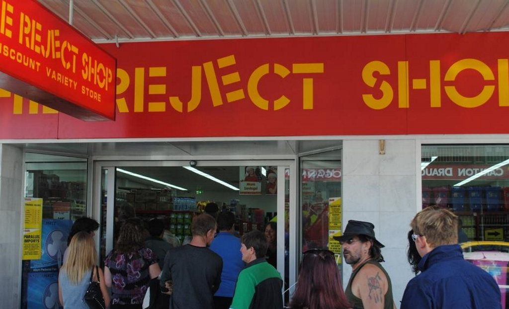 A big crowd gathers outside the Reject Shop for the official opening on Thursday.