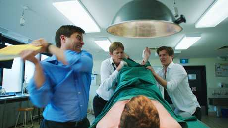 Kevin Bishop, Kris Marshall and Xavier Samuel in a scene from the movie A Few Less Men.
