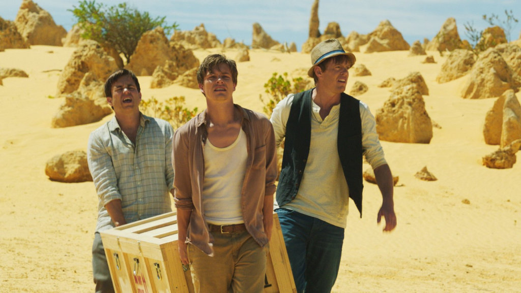 Kevin Bishop, Xavier Samuel and Marshall in a scene from the movie A Few Less Men.