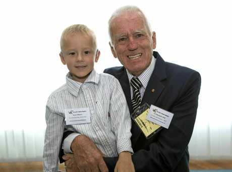 Col Reynolds with nine-year-old Queenslander, Oscar, who was diagnosed with neuroblastoma when he was three. Oscar is now doing well.