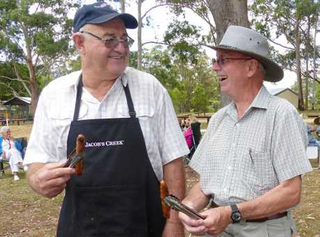 Highfields Probus members Peter Smith and Mike Spooner cooking up a treat for the car rally teams.