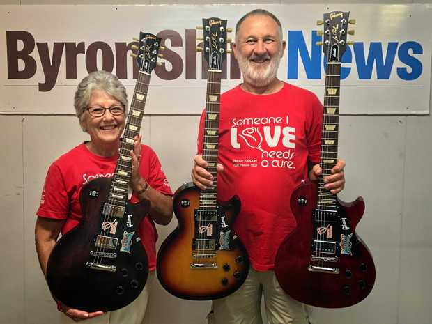 GUITAR RAFFLE: Cystic Fibrosis campaigners Jenny and Alan Tunks with the three Gibson Les Paul Studio guitars that will be raffled at Bluesfest.