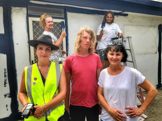 INSTALLATION:Co-Curators Rebecca Townsend and Jane Fullerton with artist Danny Gretscher. In the background are Jake and Paul from Byron Bay Painters.
