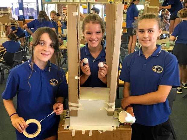CONTRAPTION: Year seven students Adel Phelong, Matilda Thornton and Bethany Woods with their ping pong roller coaster contraption.