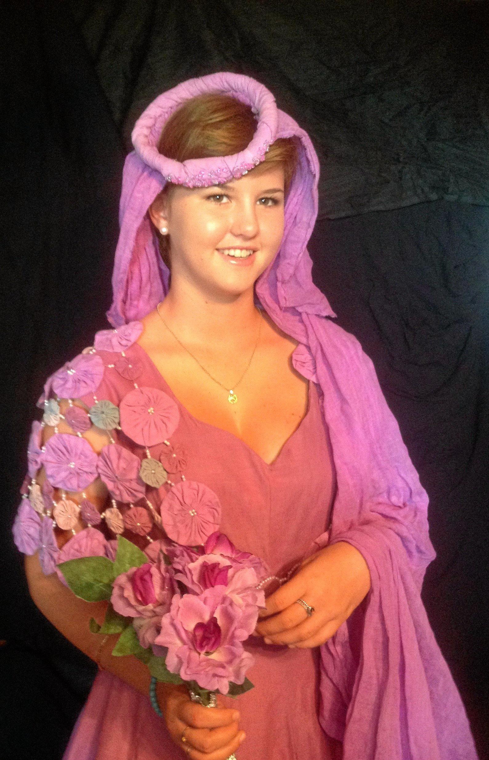 Samantha Gillespie in one of Lyn Gordon's wearable art works, a Venetian violet wedding dress.