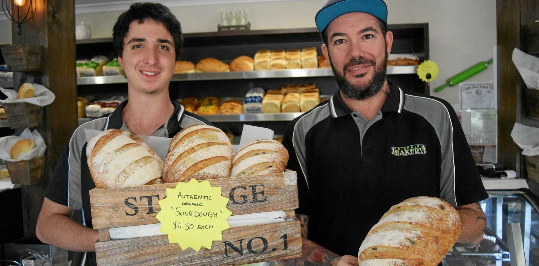 Apprentice baker Robert Day and baker Damien Hudson with Fairbairn Bakery's winning sourdough.