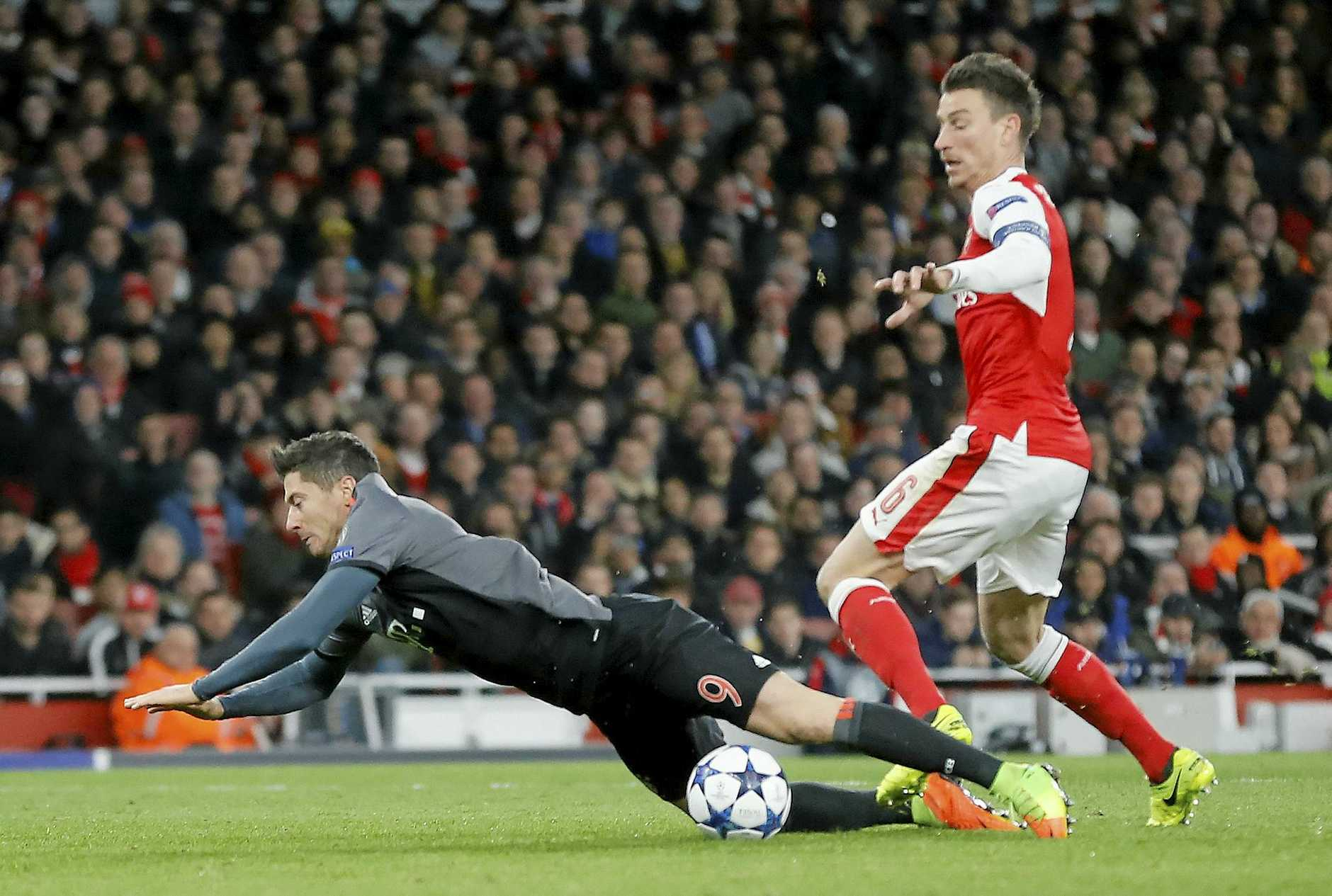 Arsenal's Laurent Koscielny, right, fouls Bayern's Robert Lewandowski to concede a penalty. Arsene Wenger said the referee got this wrong.