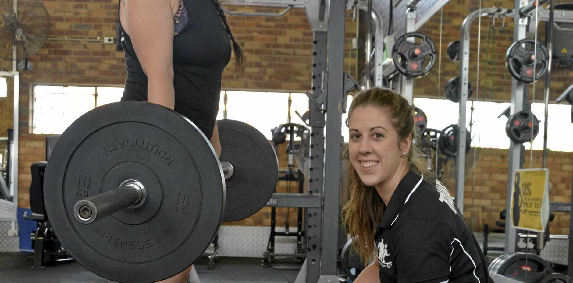 TRANSFORMED: Hayley Hunter (left) lost 20kg in 16 weeks, with the help of trainer Mandee Harbort, by learning how to transform her life by eating more and training correctly.