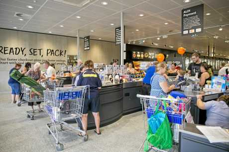 Shoppers swooped up bargains and emptied shelves at the Aldi Gladstone grand opening.