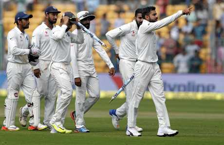 India's captain Virat Kohli leads his teammates off the field after their win over Australia in Bangalore