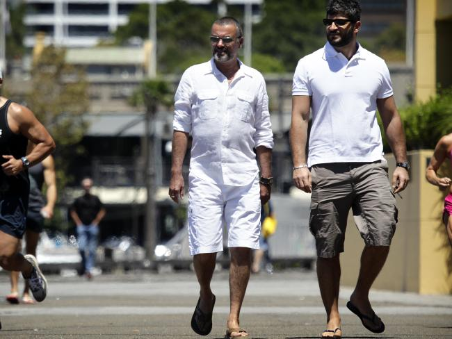 "George Michael's boyfriend Fadi Fawaz (with Michael in Sydney in 2010) called barbs aimed at him ""cruel and unneccessary."""
