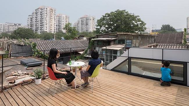 The house also allowed for a private deck. Picture: People's Architecture Office / Gao Tianxia